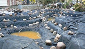 Укладка камней в пруд для разведения рыбы, aquagroup.ru