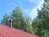 На фотографии дымоход